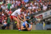 2 September 2018; Peter Harte of Tyrone tries to lift up John Small of Dublin during the GAA Football All-Ireland Senior Championship Final match between Dublin and Tyrone at Croke Park in Dublin. Photo by Ray McManus/Sportsfile