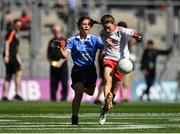 2 September 2018; Anna Murphy, Bansha NS, Co Tipperary, representing Tyrone, in action against Zara Hurley, Scoil Bhríde, Kilcullen, Co Kildare, representing Dublin, during the INTO Cumann na mBunscol GAA Respect Exhibition Go Games at the Electric Ireland GAA Football All-Ireland Minor Championship Final match between Kerry and Galway at Croke Park in Dublin. Photo by Seb Daly/Sportsfile