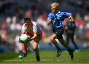 2 September 2018; Tom Ryan, Oola NS, Co Limerick, representing Tyrone, in action against Darragh Booth, Scoil Mhuire, Newbridge, Co Kildare, representing Dublin, during the INTO Cumann na mBunscol GAA Respect Exhibition Go Games at the Electric Ireland GAA Football All-Ireland Minor Championship Final match between Kerry and Galway at Croke Park in Dublin. Photo by Eóin Noonan/Sportsfile