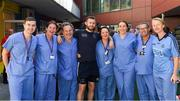 3 September 2018; Dublin footballer Jack McCaffrey with nursing staff, from left, Jordan Kinsella, Annette O'Neill, Paul Behan, Caroline Kelly, Sarah Flaherty, Robert O'Byrne, and Paula Kelly during the All-Ireland Senior Football Champions visit to Our Lady's Children's Hospital, Crumlin in Dublin. Photo by Piaras Ó Mídheach/Sportsfile