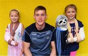 3 September 2018; Dublin footballer Con O'Callaghan with Lucy Silke, age 6, from Lucan, left, and Sophie Lawlor, age 8, from Templeogue, during the All-Ireland Senior Football Champions visit to Our Lady's Children's Hospital, Crumlin in Dublin. Photo by Piaras Ó Mídheach/Sportsfile