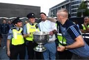 3 September 2018; Sgt Eimear Curran and Garda Joanne Olohan with Dublin footballers Michael Darragh Macauley and Eoghan O'Gara during the Dublin All-Ireland Football Winning team homecoming at Smithfield in Dublin. Photo by David Fitzgerald/Sportsfile
