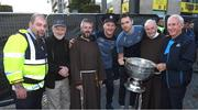 3 September 2018; Garda Michael McGrath, left, with from left to right, Fr Dermot Lynch, Fr Bryan Shorthall, Dublin footballers, Ciarán Kilkenny, Dean Rock, Brother Kevin Crowley and Jimmy Gavin, father of Dublin manager Jim Gavin, during the Dublin All-Ireland Football Winning team homecoming at Smithfield in Dublin. Photo by David Fitzgerald/Sportsfile