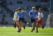 2 September 2018; Conor Fox, Tubber NS, Co Offaly, representing Dublin, in action against Stephen Curley, Corrandulla NS, Co Galway, representing Tyrone, during the INTO Cumann na mBunscol GAA Respect Exhibition Go Games at the Electric Ireland GAA Football All-Ireland Minor Championship Final match between Kerry and Galway at Croke Park in Dublin. Photo by Ray McManus/Sportsfile