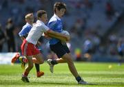 2 September 2018; Evan Moynihan, St Mary's BNS, Rathfarnham, Co Dublin, in action against Tom Curran, Barefield NS, Ennis, Co Clare, representing Tyrone, during the INTO Cumann na mBunscol GAA Respect Exhibition Go Games at the Electric Ireland GAA Football All-Ireland Minor Championship Final match between Kerry and Galway at Croke Park in Dublin. Photo by Ray McManus/Sportsfile