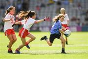 2 September 2018; Aoibhinn Sheridan, Scoil Mhuire Naofa, Carrigallen, Co Leitrim, representing Dublin, in action against Síofra Hession, Gaelscoil de hÍde, Co Roscommon, representing Tyrone, left, and Aoibhe Hoey, Jonesboro PS, Newry, Co Down, representing Tyrone, during the INTO Cumann na mBunscol GAA Respect Exhibition Go Games at the Electric Ireland GAA Football All-Ireland Minor Championship Final match between Kerry and Galway at Croke Park in Dublin. Photo by Piaras Ó Mídheach/Sportsfile