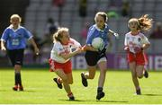 2 September 2018; Nicole Kindlon, Scoil Bhríde Mullaghrafferty, Co Monaghan, representing Dublin, in action against Sinéad Levingstone, Crubany NS, Co Cavan, representing Tyrone, during the INTO Cumann na mBunscol GAA Respect Exhibition Go Games at the Electric Ireland GAA Football All-Ireland Minor Championship Final match between Kerry and Galway at Croke Park in Dublin. Photo by Piaras Ó Mídheach/Sportsfile