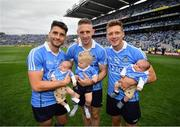 2 September 2018; Dublin's Bernard Brogan, left, and Paul Flynn, right, holding twins Keadán, left, and Donagh Borgan and Eoghan O'Gara with Fiadh O'Gara following the GAA Football All-Ireland Senior Championship Final match between Dublin and Tyrone at Croke Park in Dublin. Photo by Stephen McCarthy/Sportsfile