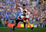 2 September 2018; Con O'Callaghan of Dublin is tackled by Mattie Donnelly of Tyrone during the GAA Football All-Ireland Senior Championship Final match between Dublin and Tyrone at Croke Park in Dublin. Photo by Brendan Moran/Sportsfile