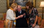 7 September 2018; President of Ireland Michael D Higgins and his wife Sabina greet team captain Katie Mullen during a reception to honour the Ireland Women's Hockey team and their performance at the 2018 Women's Hockey World Cup at Áras an Uachtaráin in Phoenix Park, Dublin. Photo by Piaras Ó Mídheach/Sportsfile