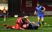 8 September 2018; Fergus McFadden of Leinster goes over to score his side's first try despite the tackle of Leigh Halfpenny, 15, and Rob Evans, 1, of Scarlets during the Guinness PRO14 Round 2 match between Scarlets and Leinster at Parc y Scarlets in Llanelli, Wales. Photo by Stephen McCarthy/Sportsfile