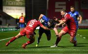 8 September 2018; Fergus McFadden of Leinster goes over to score his side's first try despite the tackle of Leigh Halfpenny, 15, and Rob Evans of Scarlets during the Guinness PRO14 Round 2 match between Scarlets and Leinster at Parc y Scarlets in Llanelli, Wales. Photo by Stephen McCarthy/Sportsfile