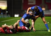 8 September 2018; Fergus McFadden is congratulated by his Leinster team-mate Jordan Larmour after scoring their side's opening try during the Guinness PRO14 Round 2 match between Scarlets and Leinster at Parc y Scarlets in Llanelli, Wales. Photo by Stephen McCarthy/Sportsfile