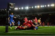 8 September 2018; Fergus McFadden of Leinster goes over to score his side's first try despite the tackle of Leigh Halfpenny, and Rob Evans, left, of Scarlets during the Guinness PRO14 Round 2 match between Scarlets and Leinster at Parc y Scarlets in Llanelli, Wales. Photo by Stephen McCarthy/Sportsfile