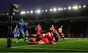 8 September 2018; Fergus McFadden of Leinster goes over to score his side's first try despite the tackle of Leigh Halfpenny, and Rob Evans, 1, of Scarlets during the Guinness PRO14 Round 2 match between Scarlets and Leinster at Parc y Scarlets in Llanelli, Wales. Photo by Stephen McCarthy/Sportsfile