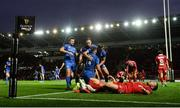 8 September 2018; Fergus McFadden, 14, is congratulated by his Leinster team-mates Ross Byrne, left, Rory O'Loughlin and Jordan Larmour, right, after scoring his side's opening try, as Rob Evans of Scarlets reacts to conceeding, during the Guinness PRO14 Round 2 match between Scarlets and Leinster at Parc y Scarlets in Llanelli, Wales. Photo by Stephen McCarthy/Sportsfile