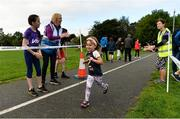 9 September 2018; parkrun Ireland in partnership with Vhi, expanded their range of junior events to 17 with the introduction of the Shelbourne Park junior parkrun on Sunday morning. Junior parkruns are 2km long and cater for 4 to 14-year olds, free of charge providing a fun and safe environment for children to enjoy exercise. Pictured is Aoife Dillane, aged 4, from Mayorstone, Limerick, being applauded by event director Lavinia Ryan-Duggan from Vhi Limerick, and her daughter Sophie Duggan, aged 11, from Corbally, as she crosses the finish line at Shelbourne Park in Limerick. Photo by Diarmuid Greene/Sportsfile