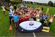 9 September 2018; parkrun Ireland in partnership with Vhi, expanded their range of junior events to 17 with the introduction of the Shelbourne Park junior parkrun on Sunday morning. Junior parkruns are 2km long and cater for 4 to 14-year olds, free of charge providing a fun and safe environment for children to enjoy exercise. Pictured are participants prior to the junior parkrun with event director Lavinia Ryan-Duggan from Vhi Limerick  at Shelbourne Park in Limerick. Photo by Diarmuid Greene/Sportsfile