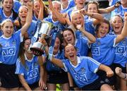 9 September 2018; Dublin players celebrate with the Kathleen Mills Cup after the Liberty Insurance All-Ireland Premier Junior Camogie Championship Final match between Dublin and Kerry at Croke Park in Dublin. Photo by Piaras Ó Mídheach/Sportsfile