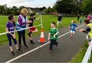 9 September 2018; parkrun Ireland in partnership with Vhi, expanded their range of junior events to 17 with the introduction of the Shelbourne Park junior parkrun on Sunday morning. Junior parkruns are 2km long and cater for 4 to 14-year olds, free of charge providing a fun and safe environment for children to enjoy exercise. Pictured are participants being applauded across the finish line by event director Lavinia Ryan-Duggan from Vhi Limerick, and her daughter Sophie Duggan, aged 11, from Corbally, at Shelbourne Park in Limerick. Photo by Diarmuid Greene/Sportsfile