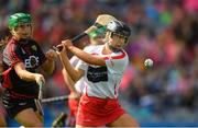 9 September 2018; Caitríona Collins of Cork scores her side's first goal despite the efforts of Allannah Savage of Down during the Liberty Insurance All-Ireland Intermediate Camogie Championship Final match between Cork and Down at Croke Park in Dublin. Photo by Piaras Ó Mídheach/Sportsfile