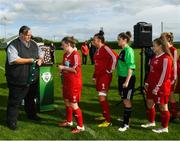 9 September 2018; Womens Football Committee member Padraig Hartnett presents TEK United players with their runners-up medals after the FAI Women's Intermediate Shield Final match between TEK United and Lakewood Athletic at Newhill Park in Two Mile Borris, Tipperary.  Photo by Harry Murphy/Sportsfile