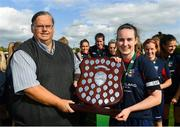 9 September 2018; Ali Brady of Lakewood Athletic is presented the shield by Womens Football Committee member Padraig Hartnett after the FAI Women's Intermediate Shield Final match between TEK United and Lakewood Athletic at Newhill Park in Two Mile Borris, Tipperary.  Photo by Harry Murphy/Sportsfile