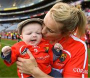 9 September 2018; Briege Corkery of Cork celebrates with her son Tadhg Scannell, age five months, following the Liberty Insurance All-Ireland Senior Camogie Championship Final match between Cork and Kilkenny at Croke Park in Dublin. Photo by Piaras Ó Mídheach/Sportsfile