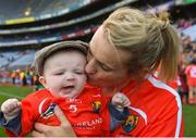 9 September 2018; Briege Corkery of Cork celebrates with her son Tadhg Scannell, age five months, after the Liberty Insurance All-Ireland Senior Camogie Championship Final match between Cork and Kilkenny at Croke Park in Dublin. Photo by Piaras Ó Mídheach/Sportsfile