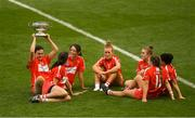 9 September 2018; Cork players, from left, Hannah Looney, Orla Cotter, Chloe Sigerson, Laura Treacy, Libby Coppinger, Orla Cronin and Gemma O'Connor relax with the O'Duffy Cup after the Liberty Insurance All-Ireland Senior Camogie Championship Final match between Cork and Kilkenny at Croke Park in Dublin. Photo by Piaras Ó Mídheach/Sportsfile