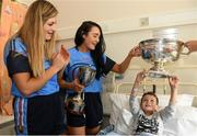 10 September 2018; Morgan Boylan, age 6, from Aughrim, Wicklow, with Cork camogie players Niamh Ní Chaoimh, right, and Sarah Harrington during the All-Ireland Senior Camogie Champions visit to Our Lady's Children's Hospital in Crumlin, Dublin. Photo by Eóin Noonan/Sportsfile