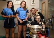 10 September 2018; Luke Pearse, age 12, from Newcastle, Dublin and his mother Ruth, with Cork camogie players Niamh Ní Chaoimh, left, and Keeva McCarthy, during the All-Ireland Senior Camogie Champions visit to Our Lady's Children's Hospital in Crumlin, Dublin. Photo by Eóin Noonan/Sportsfile