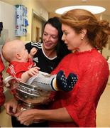 10 September 2018; Cork camogie player Aisling Thompson with Rua Buckley, age 8 months, with his mother Mairead from Aghabullogue, Cork, during the All-Ireland Senior Camogie Champions visit to Our Lady's Children's Hospital in Crumlin, Dublin. Photo by Eóin Noonan/Sportsfile