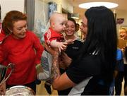 10 September 2018; Cork camogie player Aisling Thompson with Rua Buckley, age 8 months, from Aghabullogue, Cork, during the All-Ireland Senior Camogie Champions visit to Our Lady's Children's Hospital in Crumlin, Dublin. Photo by Eóin Noonan/Sportsfile