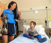 10 September 2018; Morgan Boylan, age 6, from Aughrim, Wicklow, with Cork camogie player Niamh Ní Chaoimh during the All-Ireland Senior Camogie Champions visit to Our Lady's Children's Hospital in Crumlin, Dublin. Photo by Eóin Noonan/Sportsfile