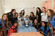 10 September 2018; Sarah McLoughlin, age 11, from Ballybofey, Donegal, with members of the Cork camogie team during the All-Ireland Senior Camogie Champions visit to Our Lady's Children's Hospital in Crumlin, Dublin. Photo by Eóin Noonan/Sportsfile