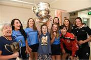 10 September 2018; Sally Fox, age 14, from Shannon, Clare, lifting the cup alongside Cork camogie players during the All-Ireland Senior Camogie Champions visit to Our Lady's Children's Hospital in Crumlin, Dublin. Photo by Eóin Noonan/Sportsfile
