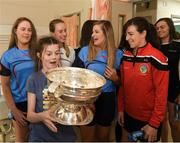 10 September 2018; Sally Fox, age 14, from Shannon, Clare, with the cup alongside Cork camogie players during the All-Ireland Senior Camogie Champions visit to Our Lady's Children's Hospital in Crumlin, Dublin. Photo by Eóin Noonan/Sportsfile