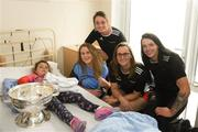10 September 2018; Holly Hobbs, age 6, from Kilanerin, Wexford, with Cork camogie players, from left, Keeva McCarthy, Aoife Murray, Chloe Sigerson and Aishling Thompson during the All-Ireland Senior Camogie Champions visit to Our Lady's Children's Hospital in Crumlin, Dublin. Photo by Eóin Noonan/Sportsfile
