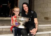 10 September 2018; Jack O'Brien, age 8, from Liscarroll, Cork, with Cork camogie player Aishling Thompson during the All-Ireland Senior Camogie Champions visit to Our Lady's Children's Hospital in Crumlin, Dublin. Photo by Eóin Noonan/Sportsfile