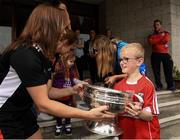 10 September 2018; Jack O'Brien, age 8, from Liscarroll Cork being presented with the cup by Cork camogie player Aoife Murray during the All-Ireland Senior Camogie Champions visit to Our Lady's Children's Hospital in Crumlin, Dublin. Photo by Eóin Noonan/Sportsfile