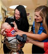 10 September 2018; Rua Buckley, age 8 months, with Cork camogie players Aishling Thompson, left, and Sarah Harrington during the All-Ireland Senior Camogie Champions visit to Our Lady's Children's Hospital in Crumlin, Dublin. Photo by Eóin Noonan/Sportsfile