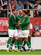 11 September 2018; Aiden O'Brien, left, of Republic of Ireland is congratulated by team-mates Callum Robinson, right and Richard Keogh after scoring his side's first goal during the International Friendly match between Poland and Republic of Ireland at the Municipal Stadium in Wroclaw, Poland. Photo by Stephen McCarthy/Sportsfile