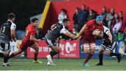 14 September 2018; Tadhg Beirne of Munster, supported by team-mate Joey Carbery, breaks clear of Scott Baldwin of Ospreys during the Guinness PRO14 Round 3 match between Munster and Ospreys at Irish Independent Park in Cork. Photo by Brendan Moran/Sportsfile