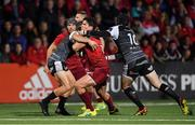 14 September 2018; Joey Carbery of Munster is tackled by Tom Habberfield, left, and Sam Davies of Ospreys during the Guinness PRO14 Round 3 match between Munster and Ospreys at Irish Independent Park in Cork. Photo by Brendan Moran/Sportsfile