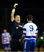 14 September 2018; Referee Paul O'Brien shows Sean Goulding of Home Farm a yellow card during the Leinster Senior League match between Greystones United and Home Farm at Woodlands in Greystones, Co Wicklow.  Photo by Matt Browne/Sportsfile