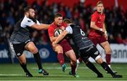 14 September 2018; Ian Keatley of Munster is tackled by Alex Jeffries and Olly Cracknell of Ospreys during the Guinness PRO14 Round 3 match between Munster and Ospreys at Irish Independent Park in Cork. Photo by Brendan Moran/Sportsfile