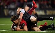 14 September 2018; Darren Sweetnam of Munster goes over to score his side's seventh try despite the tackle of Tom Williams of Ospreys during the Guinness PRO14 Round 3 match between Munster and Ospreys at Irish Independent Park in Cork. Photo by Brendan Moran/Sportsfile