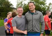 15 September 2018; parkrun Ireland in partnership with Vhi, added their 100th event on Saturday, 15th September, with the introduction of the Tyrrelstown parkrun in Co. Dublin. Pictured is Taoiseach Leo Varadkar, T.D. with Gerry Mooney, Irish Independent photographer. parkruns take place over a 5km course weekly, are free to enter and are open to all ages and abilities, providing a fun and safe environment to enjoy exercise. To register for a parkrun near you visit www.parkrun.ie. Photo by Piaras Ó Mídheach/Sportsfile