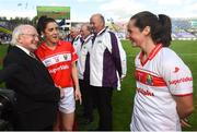 16 September 2018; President of Ireland Michael D Higgins meets Cork captain Ciara O'Sullivan, left, and Martina O'Brien prior to the TG4 All-Ireland Ladies Football Senior Championship Final match between Cork and Dublin at Croke Park, Dublin. Photo by David Fitzgerald/Sportsfile